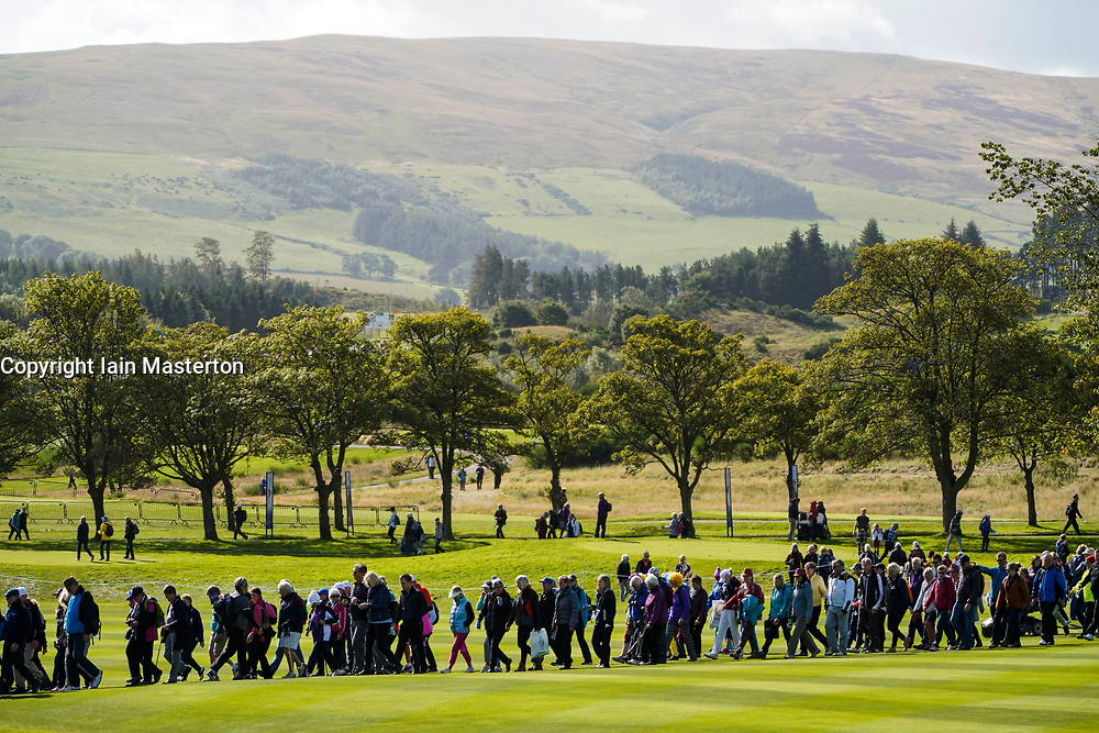 Solheim Cup 2019 at Centenary Course at Gleneagles in Scotland, UK, Spectators crossing fairway on sunny day on Sunday.