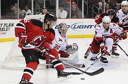 Feb 16; Newark, NJ, USA; Carolina Hurricanes goalie Cam Ward (30) makes a save on New Jersey Devils defenseman Andy Greene (6) during the second period at the Prudential Center.