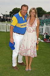 The MARQUESS & MARCHIONESS OF MILFORD HAVEN at the Queen's Cup polo final sponsored by Cartier at Guards Polo Club, Smith's Lawn, Windsor Great Park on 18th June 2006.  The Final was between Dubai and the Broncos polo teams with Dubai winning.<br />