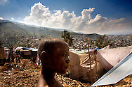 Kids play with kites in the refugee camp of Carrefour Feuilles, Haiti on Jan. 20, 2010. Carrefour  Feuilles is one of the neighborhoods that was hit in the major earthquake with most of it's buildings destroyed. The people of this neighborhood live in sheds above the old neighborhood without water and very bad conditions.