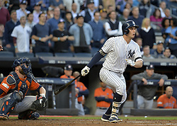 October 18, 2017 - Bronx, NY, USA - The New York Yankees' Greg Bird hits an RBI single in the second inning against the Houston Astros in Game 5 of the American League Championship Series at Yankee Stadium in New York on Wednesday, Oct. 18, 2017. (Credit Image: © Howard Simmons/TNS via ZUMA Wire)