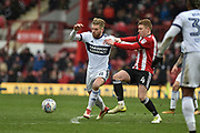 Middlesbrough Midfielder, Adam Clayton (8) is challenged by Brentford Midfielder, Lewis Macleod (4) during the EFL Sky Bet Championship match between Brentford and Middlesbrough at Griffin Park, London, England on 17 March 2018. Picture by Adam Rivers.