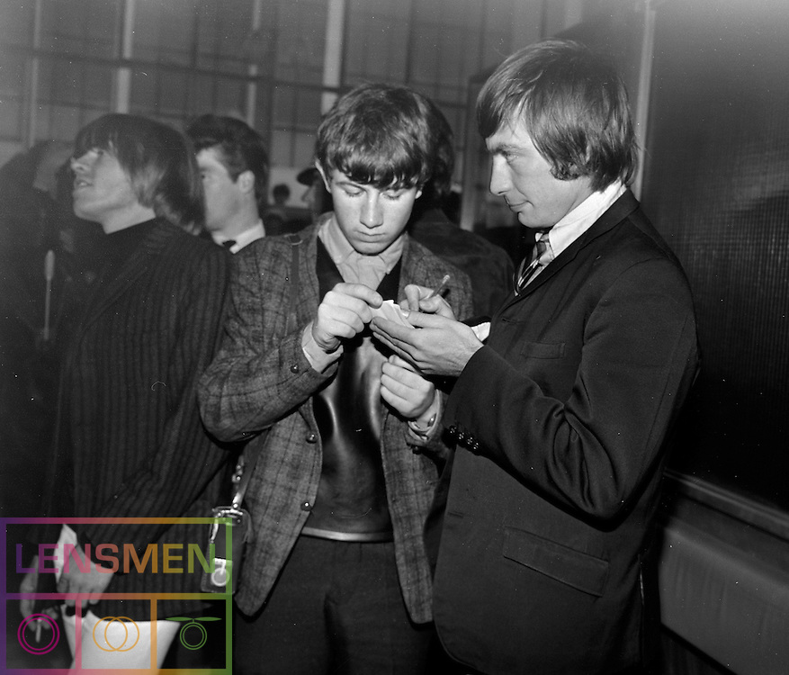 The Rolling Stones Charlie is my Darling - Ireland 1965 -..Charlie Watts of The Rolling Stones sighns an autograph for a young fan, while bandmate Brian Jones sees something interesting at Dublin Airport, before thier concert in the Adelphi Theatre, Middle Abbey Street, Dublin. This was the band's second Irish tour of 1965...03/09/1965..09/03/1965..03 September 1965...The Rolling Stones Charlie is my Darling - Ireland 1965.Out November 2nd from ABKCO.Super Deluxe Box Set/Blu-ray and DVD Details Revealed. .ABKCO Films is proud to join in the celebration of the Rolling Stones 50th Anniversary by announcing exclusive details of the release of the legendary, but never before officially released film, The Rolling Stones Charlie is my Darling - Ireland 1965.  The film marked the cinematic debut of the band, and will be released in Super Deluxe Box Set, Blu-ray and DVD configurations on November 2nd (5th in UK & 6th in North America).. .The Rolling Stones Charlie is my Darling - Ireland 1965 was shot on a quick weekend tour of Ireland just weeks after ?(I Can't Get No) Satisfaction? hit # 1 on the charts and became the international anthem for an entire generation.  Charlie is my Darling is an intimate, behind-the-scenes diary of life on the road with the young Rolling Stones featuring the first professionally filmed concert performances of the band's long and storied touring career, documenting the early frenzy of their fans and the riots their live performances incited.. .Charlie is my Darling showcases dramatic concert footage - including electrifying performances of ?The Last Time,? ?Time Is On My Side? and the first ever concert performance of the Stones counterculture classic, ?(I Can't Get No) Satisfaction.?  Candid, off-the-cuff interviews are juxtaposed with revealing, comical scenes of the band goofing around with each other. It's also an insider's glimpse into the band's developing musical style by blending blues, R&B and rock-n-roll riffs, and the film captures