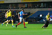 Gareth Evans (26) of Portsmouth shoots at goal and has his shot saved by Sam Eastwood (1) of Oxford United during the Leasing.com EFL Trophy match between Oxford United and Portsmouth at the Kassam Stadium, Oxford, England on 8 October 2019.