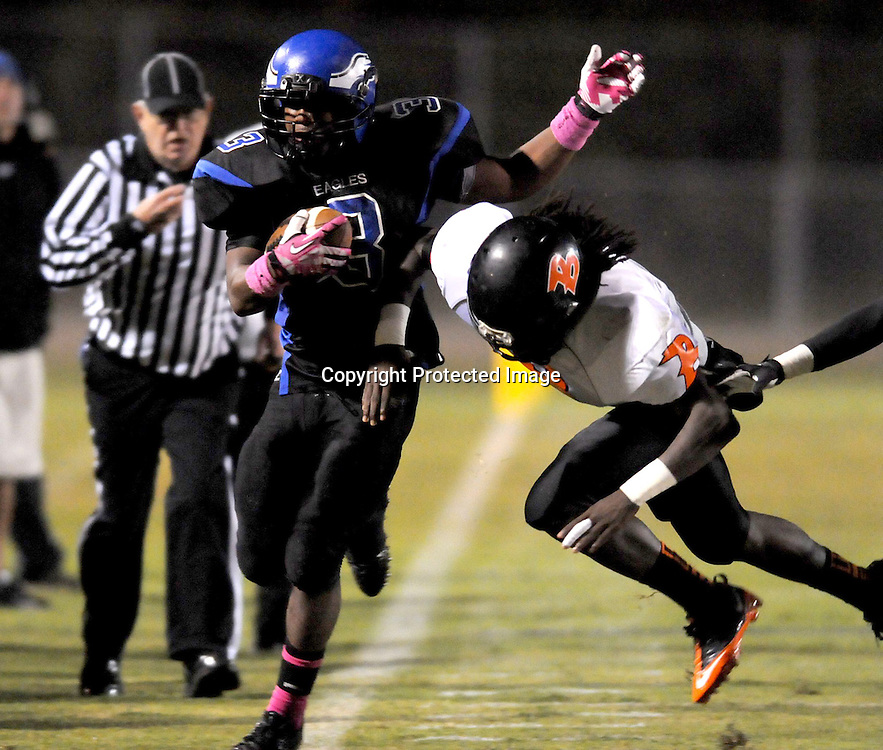 East Bladen's Jaylan Herring is pushed out of bounds by Wallace-Rose Hill's Johnnie Glaspie. (Jason A. Frizzelle)