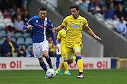 AFC Wimbledon midfielder Chris Whelpdale (11) and Rochdale FC midfielder Matthew Lund (8) in action during the EFL Sky Bet League 1 match between Rochdale and AFC Wimbledon at Spotland, Rochdale, England on 27 August 2016. Photo by Stuart Butcher.