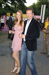 KATRA BULLER and NAT ROTHSCHILD at the Serpentine Gallery Summer party sponsored by Yves Saint Laurent held at the Serpentine Gallery, Kensington Gardens, London W2 on 11th July 2006.<br />
