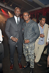 Left to right, OZWALD BOATENG and DAVID HAREWOOD at the UK launch of the Ferrari California T held at Somerset House, the Strand, London on 24th April 2014.