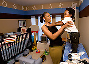 7/6/07 3:47:43 PM -- Houston, TX, U.S.A. -- Tina Thompson of the Houston Comets dresses her son, Dyllan Thompson-Jones, 2, before leaving for a game against the Seattle Storm July 6, 2007 in Houston. Thompson is the only active WNBA player  who was with the league when it started ten years ago.