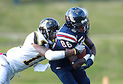 Samford wide receiver Gavin Sinclair (86) is tackled by Appalachian State wide receiver Andrew Peacock (11) at Seibert Stadium in Homewood, Ala., Saturday, Oct 13, 2012. (Marvin Gentry)