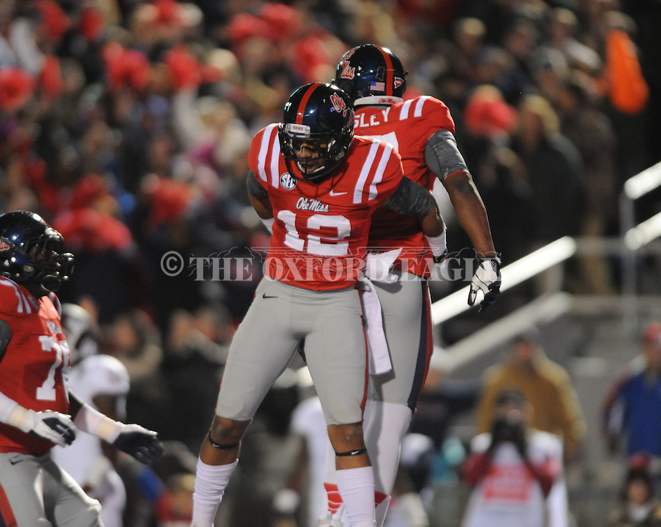 Ole Miss tight end Jamal Mosley (17) and Ole Miss wide receiver Donte Moncrief (12) celebrate a touchdown at Vaught Hemingway Stadium in Oxford, Miss. on Saturday, November 24, 2012. Ole Miss won 41-24.