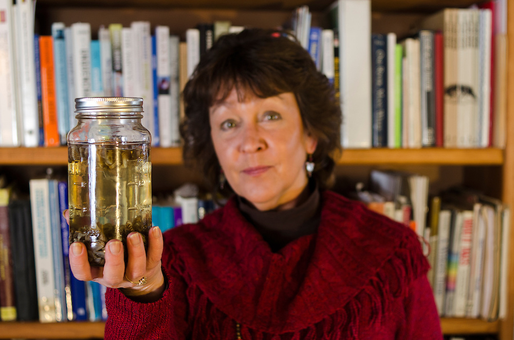 Denise Rue-Pastin, director of the Water Information Program in southwestern Colorado displays a mason jar containing invasive zebra mussles which she uses to illustrate the ecological threats effecting water quality regionally.