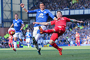 Everton defender Ramiro Funes Mori and Liverpool defender Alberto Moreno  during the Barclays Premier League match between Everton and Liverpool at Goodison Park, Liverpool, England on 4 October 2015. Photo by Simon Davies.