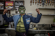 Convenience store clerk dressed at the Hulk on Halloween in Shibuya. Tokyo, Japan.
