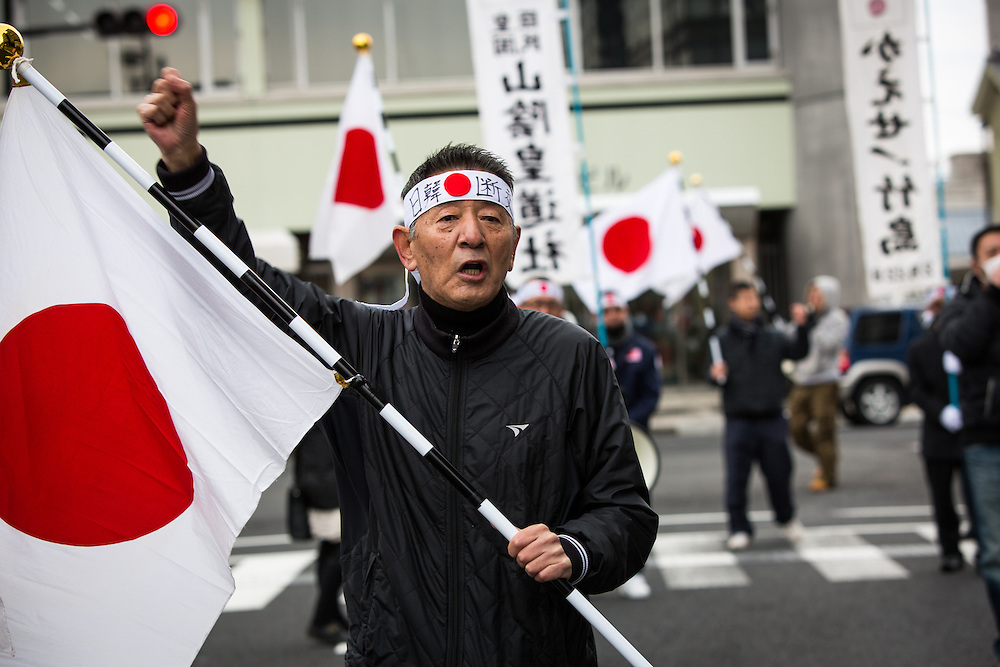 MATSUE, JAPAN - FEBRUARY 22 : Japanese nationalists march with flags to protest South Korea to return disputed islets prior to the Takeshima Sovereignty Ceremony, a small disputed island controlled by South Korea which it calls Dokdo and Japan calls it Takeshima, in Matsue in Shimane Prefecture, western Japan on Feb. 22, 2017. Japan urged South Korea to return disputed islets, The sovereignty issue over the islands has been the subject of a long territorial dispute between South Korean and Japan. (Photo by Richard Atrero de Guzman/NUR Photo)