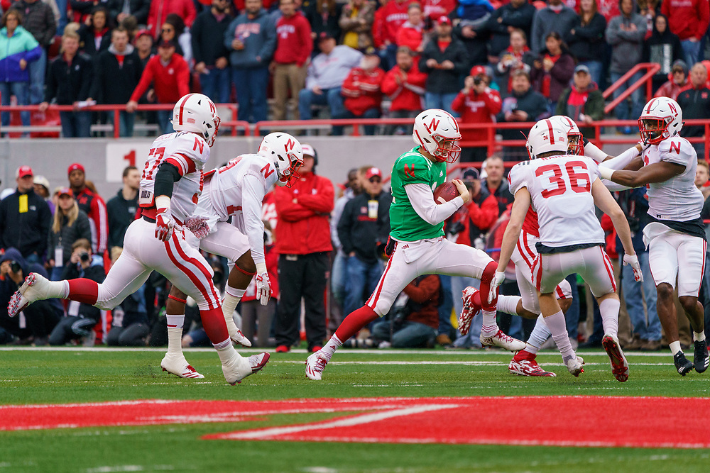 Tristan Gebbia #14 scrambles during Nebraska's annual Spring Game at Memorial Stadium in Lincoln, Neb., on April 21, 2018. © Aaron Babcock