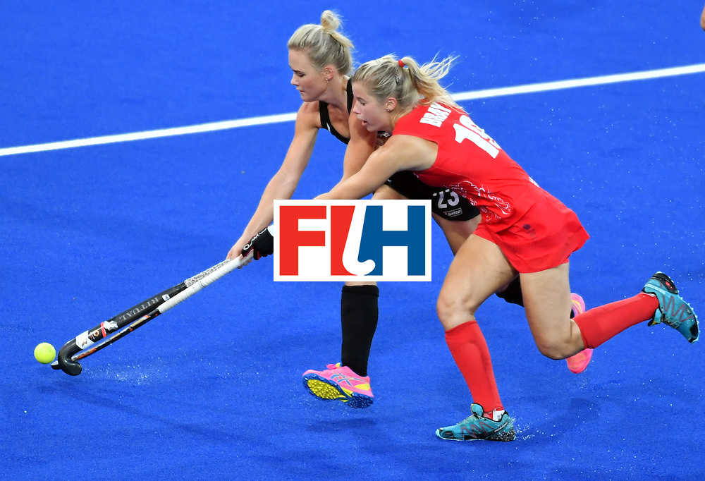 New Zealand's Charlotte Harrison (L) vies with Britain's Sophie Bray during the women's semifinal field hockey New Zealand vs Britain match of the Rio 2016 Olympics Games at the Olympic Hockey Centre in Rio de Janeiro on August 17, 2016. / AFP / Pascal GUYOT        (Photo credit should read PASCAL GUYOT/AFP/Getty Images)
