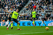 Ayoze Perez (#17) of Newcastle United shoots and scores Newcastle United's second goal (2-0) during the Premier League match between Newcastle United and Huddersfield Town at St. James's Park, Newcastle, England on 23 February 2019.