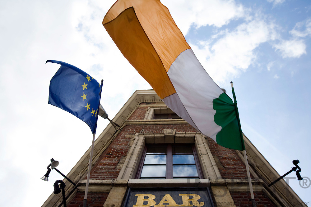 BRUSSELS - BELGIUM - 13 JUNE 2008 -- The European Union and Irish flags side by side as a symbol of the outcome of the Irish referendum on the Treaty of Lisbon seen from the Irish kitty O'Shea's Pub, next to the European Commission Building Berlaymont.  Photo: Erik Luntang