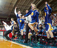 The Wichita Collegiate Spartan bench including Abby Clem, second from right, and Sam Schoenhofer, right, erupts in celebration after taking the lead in the third quarter of the 3A girls state championship game Saturday, March 11, 2006 in Hutchinson, Kan. Collegiate defeated Burlington 38-33. (AP Photo/The Hutchinson News, Travis Morisse)