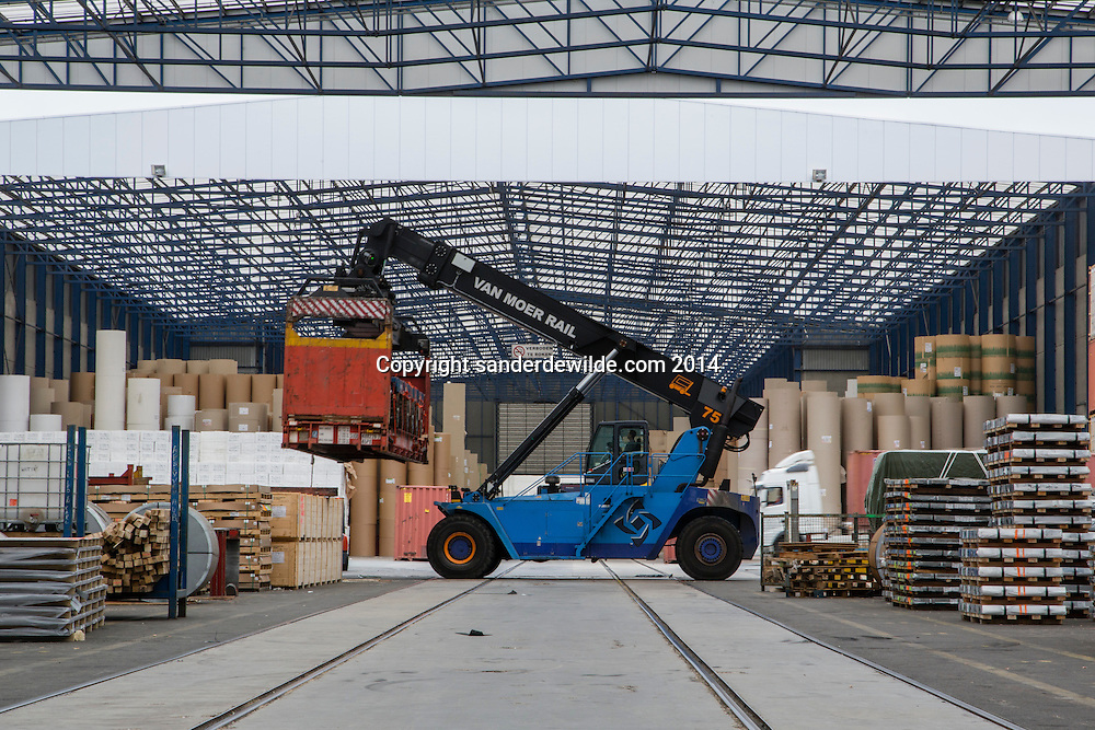 A transport vehicle lifts a container at Van Moer Rail stock hall at the port of Antwerp on 8 may 2014