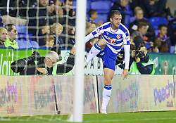READING, ENGLAND - Tuesday, September 22, 2015: Reading's Andrew Taylor lands on top of photographer Robert Noyes during the Football League Cup 3rd Round match against Everton at the Madejski Stadium. (Pic by David Rawcliffe/Propaganda)