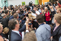 © Licensed to London News Pictures. 16/5/17  BRADFORD  , UK.  <br /> Labour's General Election Manifesto launch 2017.  JEREMY CORBYN , Leader of the Labour Party, launches the party's manifesto at an event in Bradford today (Tuesday 16th May 2017). He was joined by members of the Shadow Cabinet at the launch at University of Bradford, Richmond Building, Richmond Road, Bradford.<br /> Copies of the manifesto are handed to journalists and Labour supporters.<br />   <br /> Photo credit: CHRIS BULL/LNP