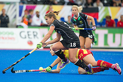 Germany's Lisa Altenburg is tackled by Christina Guinea of Spain. Germany v Spain - 3rd/4th Playoff Unibet EuroHockey Championships, Lee Valley Hockey & Tennis Centre, London, UK on 30 August 2015. Photo: Simon Parker