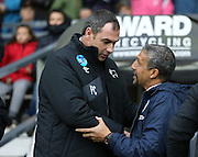 Brighton Manager, Chris Hughton and Derby manager Paul Clement during the Sky Bet Championship match between Derby County and Brighton and Hove Albion at the iPro Stadium, Derby, England on 12 December 2015.