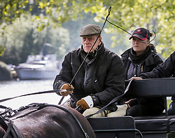 © Licensed to London News Pictures. 10/05/2017. Windsor, UK. Prince Philip, The Duke of Edinburgh,  drives his carriage on the first day of the Royal Windsor Show. The five day equestrian event takes place in the grounds of Windsor Castle. Photo credit: Peter Macdiarmid/LNP