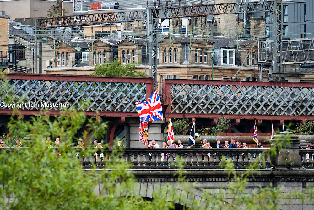 View of Union Jack flag on Orange Walk parade crossing bridge in central Glasgow , Scotland, United Kingdom