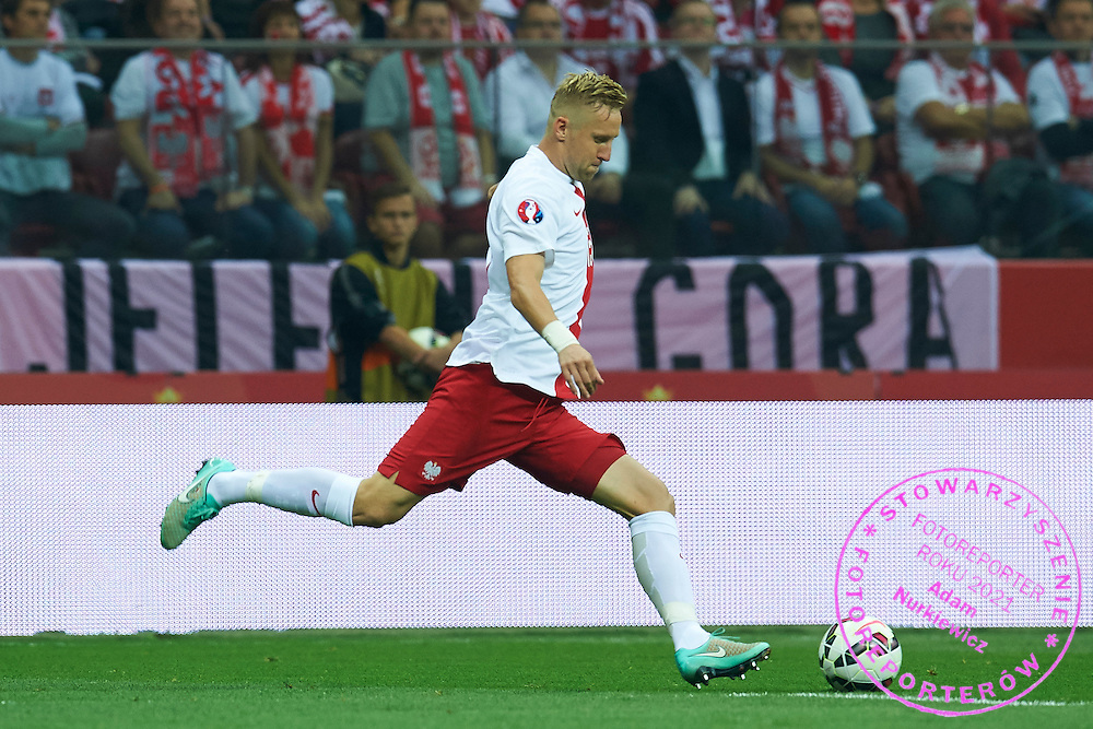 Poland's Kamil Glik controls the ball during the EURO 2016 qualifying match between Poland and Germany on October 11, 2014 at the National stadium in Warsaw, Poland<br /> <br /> Picture also available in RAW (NEF) or TIFF format on special request.<br /> <br /> For editorial use only. Any commercial or promotional use requires permission.<br /> <br /> Mandatory credit:<br /> Photo by &copy; Adam Nurkiewicz / Mediasport