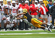 September 25 2010: Iowa Hawkeyes cornerback Micah Hyde (18) breaks up a pass intended for Ball State Cardinals wide receiver Otis Brown (87) during the first half of the NCAA football game between the Ball State Cardinals and the Iowa Hawkeyes at Kinnick Stadium in Iowa City, Iowa on Saturday September 25, 2010. Iowa defeated Ball State 45-0.