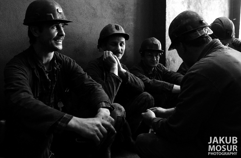 A group of coalminers sit and wait to enter the the Piast Coalmine in Bierun, Poland on April 10, 2002..Photo by Jakub Mosur