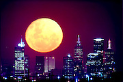 Moon over Melbourne - Melbourne skyline. .[Advised by Craig 3/1/06 that this image has not been digitally altered. It was taken about 10kms out of town with a 1200mm lens.] This photograph can be used for non commercial uses with attribution. Credit: Craig Sillitoe Photography / http://www.csillitoe.com<br /> <br /> It is protected under the Creative Commons Attribution-NonCommercial-ShareAlike 4.0 International License. To view a copy of this license, visit http://creativecommons.org/licenses/by-nc-sa/4.0/.