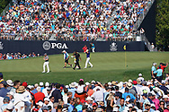 Rory McIlroy (NIR) and Justin Thomas (USA) and Tiger Woods (USA) putt on the 18th hole during the second round of the 100th PGA Championship at Bellerive Country Club, St. Louis, Missouri, USA. 8/11/2018.<br /> Picture: Golffile.ie   Brian Spurlock<br /> <br /> All photo usage must carry mandatory copyright credit (© Golffile   Brian Spurlock)
