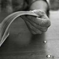 A old persons hand holding a book