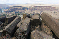 Stacked basalt columns at base of cliff in north central Oregon USA.
