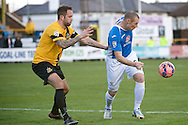 Luke Foster (left) and James Constable of Eastleigh (right) during the The FA Cup match at Haig Avenue, Southport<br /> Picture by Ian Wadkins/Focus Images Ltd +44 7877 568959<br /> 07/12/2014