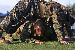 May 1, 2017 - Hawaii, U.S. - Building a House. Marine Corps Cpl. ISRAEL PRATER crawls under his squad at the beginning of the 'build a house' exercise for a martial arts course at Marine Corps Base Hawaii, May 1, 2017. The three-week long course puts students through various training that includes physical training and evaluations on properly teaching techniques. Prater is an air support operations operator assigned to the 11th Marine Expeditionary Unit. Marine Corps photo by Cpl. Zachary Orr. (Credit Image: ? Zachary Orr/DoD via ZUMA Wire/ZUMAPRESS.com)