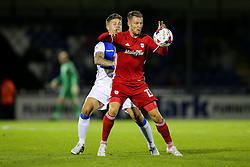 Anthony Pilkington of Cardiff City is challenged by James Clarke of Bristol Rovers - Rogan Thomson/JMP - 11/08/2017 - FOOTBALL - Memorial Stadium - Bristol, England - Bristol Rovers v Cardiff City - EFL Cup First Round.