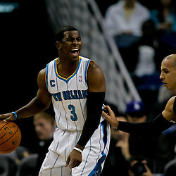 November 5, 2010; New Orleans, LA, USA; New Orleans Hornets point guard Chris Paul (3) is guarded by Miami Heat point guard Carlos Arroyo (8) during a game at the New Orleans Arena. The Hornets defeated the Heat 96-93. Mandatory Credit: Derick E. Hingle