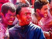 12 MARCH 2017 - BHAKTAPUR, NEPAL:  Men covered in powder and water at the Holi celebration in Bhaktapur. Holi, a Hindu religious festival, has become popular with non-Hindus in many parts of South Asia, as well as people of other communities outside Asia. The festival signifies the victory of good over evil, the arrival of spring, end of winter, and for many a festive day to meet others. Holi celebrations in Nepal are not as wild as they are in India.    PHOTO BY JACK KURTZ