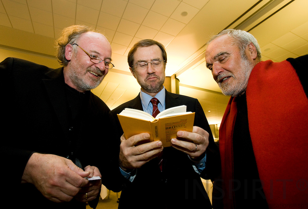 BRUSSELS - BELGIUM - 26 MARCH 2008 --  From left Lojze WIESER, writer of Europa Erlesen, MEP Alojz PETERLE, Slovenia, and Valentin OMAN, painter of the ECCE HOMO, with one of Wiesers books at the opening of their exhibition in the EU Parliament. Photo: Erik Luntang