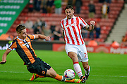Hull City striker Greg Luer (32) tackles Stoke City defender Dionatan Teixeira during the EFL Cup match between Stoke City and Hull City at the Britannia Stadium, Stoke-on-Trent, England on 21 September 2016. Photo by John Marfleet.