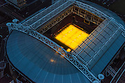 Nederland, Noord-Holland, Amsterdam, 16-01-2014; Amsterdam Zuidoost,  stadion Arena. Dak van het stadion is geopend, het gras van het voetbaldveld wordt belicht door speciale groeilampen.<br /> Amsterdam Zuidoost, Arena Ajax Stadium. The stadium roof is open, the grass of the football field is lighted using special grow lights.<br /> luchtfoto (toeslag op standaard tarieven);<br /> aerial photo (additional fee required);<br /> copyright foto/photo Siebe Swart.