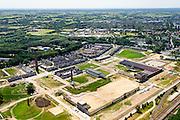Nederland, Gelderland, Ede, 09-06-2016; gebiedsontwikkeling Enka-terrein, voormalige kunstzijdefabriek van Enka met karakteristiek poortgebouw.. Op het terrein komt voornamelijk woningbouw, een deel van de industriele monumenten blijft bestaan.<br /> Project development Enka site, former rayon factory, part of the industrial monuments will remain.<br /> <br /> aerial photo (additional fee required);<br /> copyright foto/photo Siebe Swart