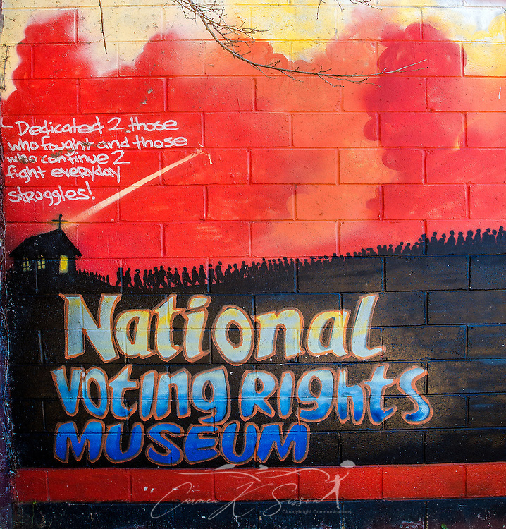 "A mural honoring past and present civil rights activists is painted on a building at Civil Rights Memorial Park, Feb. 7, 2015, in Selma, Alabama. The park was established in 2001 and includes murals and plaques honoring those who led the Civil Rights movement in Selma in the 1960's. The mural was part of the ""Liberation Summer Project"" in 1999. (Photo by Carmen K. Sisson/Cloudybright)"