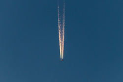 THEMENBILD - eine Boeing 777 bei der Alpenüberquerung hinterlässt Kondensstreifen am Himmel, aufgenommen am 18. Mai 2017, Zell am See, Österreich // a Boeing 777 during the crossing of the Alps, leaving vapor trails in the sky over Zell am See, Austria on 2017/05/18. EXPA Pictures © 2017, PhotoCredit: EXPA/ JFK