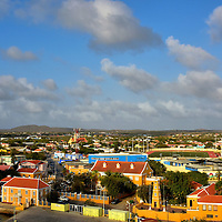 Introduction to Kralendijk and Bonaire<br /> With only 18,000 residents, Bonaire is the least populated of the ABC Islands. It was discovered by the Spanish in 1499. This municipality of the Netherlands is part of the BES Islands and the Dutch Caribbean. Bonaire&rsquo;s position just north of the equator provides a warm, tropical climate filled with sunshine. However, it does not have gorgeous beaches or mega resorts similar to many Caribbean destinations. The capital city of Kralendijk is fun to explore, assuming you do not require a shopping mecca or lots of historical landmarks. Instead, Bonaire&rsquo;s biggest asset is miles of unspoiled coral reefs renowned by divers. Bon Bini! This means &ldquo;welcome&rdquo; in Papiamento.